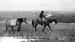 Cowboy rides away